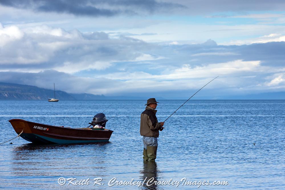 Fly fishing for salmon from a skiff on Katchemak Bay near Homer, Alaska.