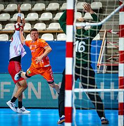 The Dutch handball player Jeffrey Boomhouwer in action during the European Championship qualifying match against Turkey in the Topsport Center Almere.