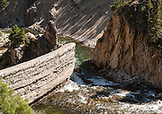 The Sunbeam Dam, on the Salmon River, Idaho, was built in 1910 to make electricity for the Sunbeam Mine, which was abandoned in 1911 after bankruptcy. The cliff was breached in 1934 to allow salmon and steelhead to migrate to their spawning beds.