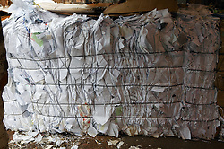Bale of waste paper at collection point,