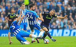Everton's Nikola Vlasic (right) is brought down by Brighton & Hove Albion's Lewis Dunk during the Premier League match at the AMEX Stadium, Brighton.