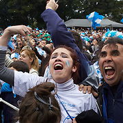 Fans watching live on a big screen in San Martin Square, Buenos Aires, react as Gonzalo Higuaín scores Argentina's second goal against Mexico during the World Cup in South Africa. 27th June 2010. Photo Tim Clayton..