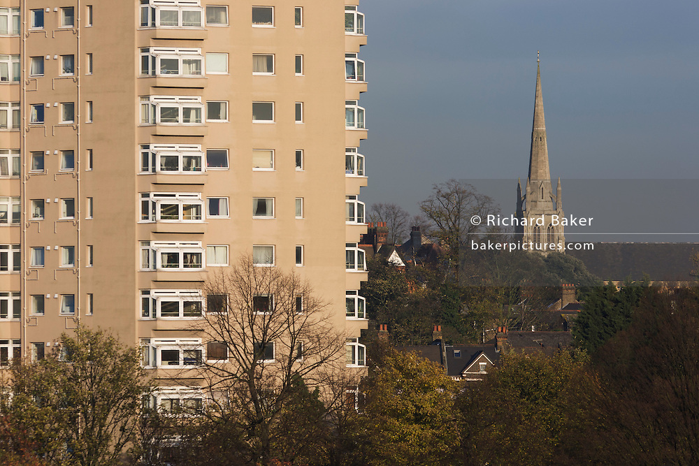 High-rise flats and spire of St. Paul's Church seen from Brockwell Park, Herne Hill, South London.