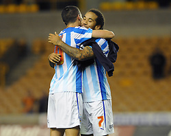 Huddersfield Town's goalscorers Conor Coady and Sean Scannell celebrate their 1 - 3 win at full time - Photo mandatory by-line: Dougie Allward/JMP - Mobile: 07966 386802 - 01/10/2014 - SPORT - Football - Wolverhampton - Molineux Stadium - Wolverhampton Wonderers v Huddersfield Town - Sky Bet Championship