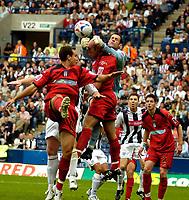 Photo: Ed Godden.<br />West Bromwich Albion v Colchester United. Coca Cola Championship. 19/08/2006. Colchester keeper Aiden Davison clears the ball.