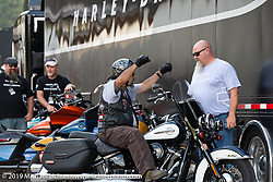 Harley-Davidson Demo Coordinator Walt Nunley helped Joseph Sanchez of Denver, CO at the Harley-Davidson test ride Pop-Up in Deadwood. It was a popular new addition for 2019 where riders could take out a Harley for a full hour on the beautiful Black Hills twisty's during the Sturgis Black Hills Motorcycle Rally. SD, USA. Friday, August 9, 2019. Photography ©2019 Michael Lichter.