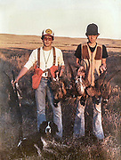 Keith Crowley (Left) and Darren Brockel with Crowley's Springer spaniel Briar, on a South Dakota pheasant hunt, ca. 1981. Photo courtesy Keith Crowley