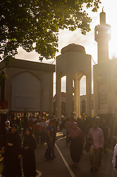 London, June 25th 2017. Dawn breaks over the London Central Mosque in Regent's Park as Muslims celebrate Eid ul-Fitr Day. PICTURED: Muslims leave the Mosque after 7am prayers.