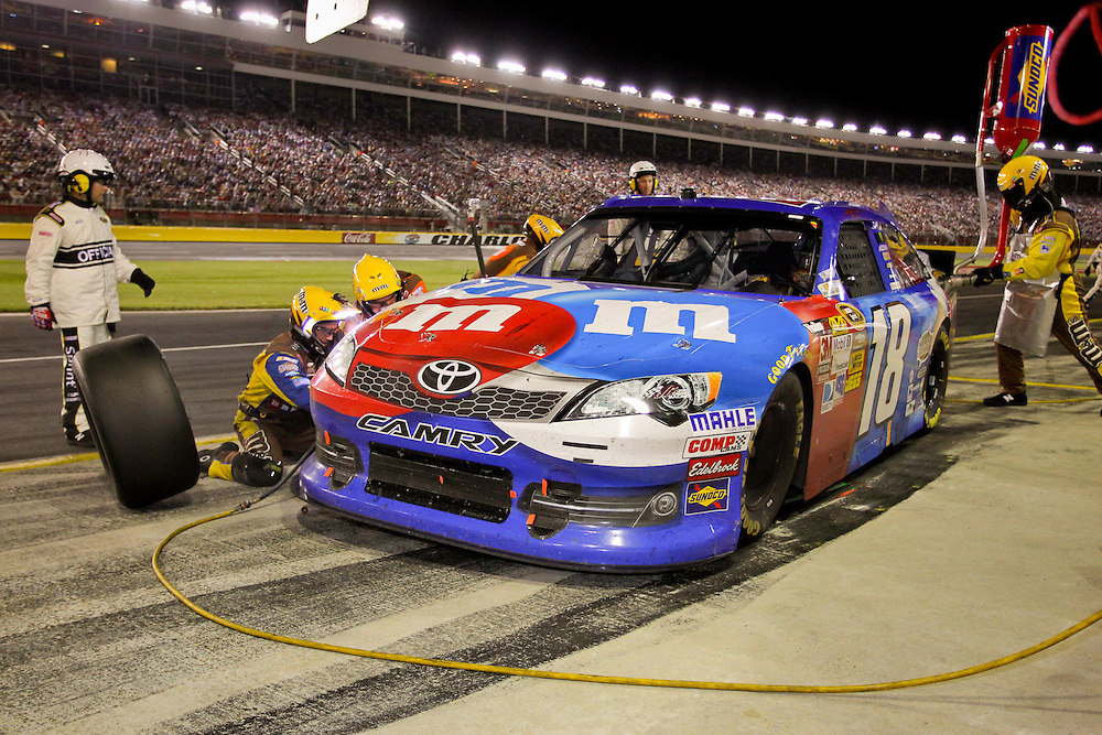 May 24, 2012; Concord, NC USA; NASCAR Sprint Cup Series driver Kyle Busch (18) pits during the Coca-Cola 600 at Charlotte Motor Speedway. Photo by Kevin Liles/kevindliles.com