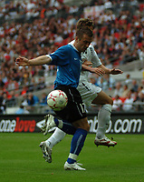 Photo: Tony Oudot.<br /> England v Estonia. UEFA European Championships Qualifying. 13/10/2007.<br /> Enar Jaager of Estonia beats Michael Owen to the ball