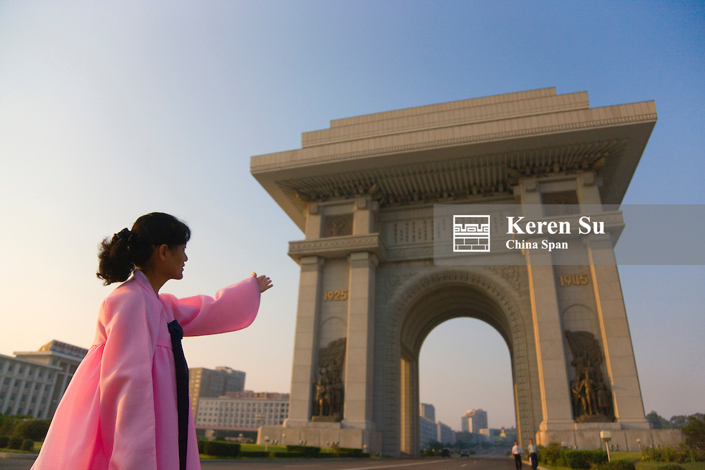 Korean woman with Arch of Triumph, Pyongyang, North Korea