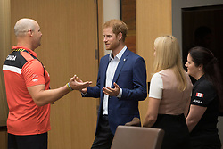 Prince Harry talks with Canadian veteran Mike Trauner, left, as Trauner's wife Leah Cuffe, right, and moderator Bronwen Evans look on during a reception before attending the True Patriot Love Symposium, in Toronto on Friday, September 22, 2017. Photo by Chris Young/The Canadian Press/ABACAPRESS.COM