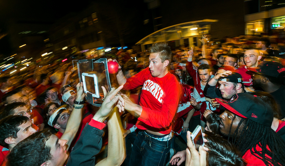 Badgers fans play a game of impromptu basketball on State Street after Wisconsin's 71-64 win over Kentucky. (Photo © Andy Manis)