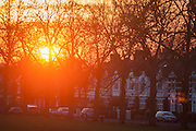 As an urban sun sets, Edwardian period homes in a south London street, on 19th January 2017, in Ruskin Park, London borough of Lambeth, England.