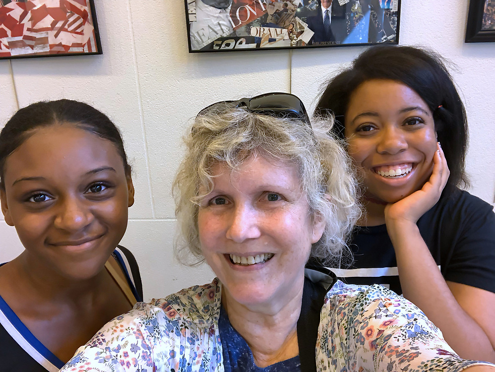 Freeport, New York, U.S. August 14, 2018. Trio with same birthday take selfie in lobby of Freeport Memorial Library, on Long Island.