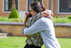 © Licensed to London News Pictures. 10/08/2021.Leeds,UK. Chamequa Rankine,18 and Edith Brightwell,18, celebrate their Α level results at The Grammar School at Leeds. Photo credit: Ioannis Alexopoulos/LNP