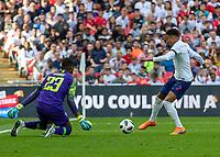 Football - 2018 International Friendly (pre-World Cup warm-up) - England vs. Nigeria<br /> <br /> Jesse Lingard (England) tries to beat Francis Uzoho (Nigeria) from close range at Wembley Stadium.<br /> <br /> COLORSPORT/DANIEL BEARHAM