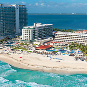 Golden Parnassus, Secrets The Vine and Sandos Cancun hotels.