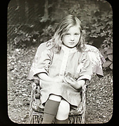 Magic lantern slide c 1900-1910 halftone portrait of pretty young girl sitting in a chair
