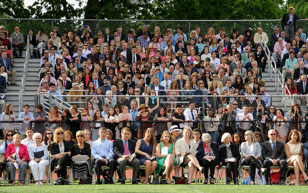 A crowd fills around the track during the 148th Graduation exercises at Wellesley High School on June, 2, 2017.   [Wicked Local Photo/James Jesson]