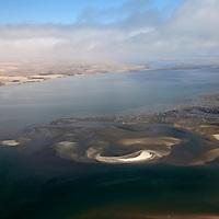 Africa, Namibia, Walvis Bay. Aerial view of Namib Rand Desert coast, where the desert meets the sea.