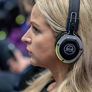 People wearing headphone listen to a speaker at London Tech Week at Excel London,on 12 June 2019, UK