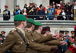 © London News Pictures. 13/03/2015. Prince Harry, Catherine Duchess of Cambridge and Prince William  watch as current and former military parade past St Paul's Cathedral as part of a service of commemoration to mark the end of combat operations in Afghanistan, at St Paul's Cathedral in London. Photo credit: Ben Cawthra/LNP