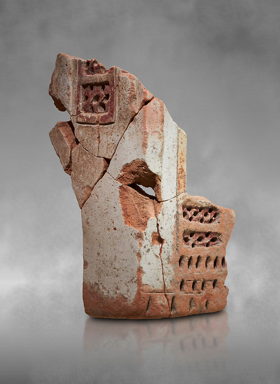 Hittite terra cotta fragmants of a defenive wall tower shaped vessel . Hittite Period, 1600 - 1200 BC.  Hattusa Boğazkale. Çorum Archaeological Museum, Corum, Turkey. Against a grey bacground. .<br />  <br /> If you prefer to buy from our ALAMY STOCK LIBRARY page at https://www.alamy.com/portfolio/paul-williams-funkystock/hittite-art-antiquities.html  - Hattusa into the LOWER SEARCH WITHIN GALLERY box. Refine search by adding background colour, place,etc<br /> <br /> Visit our HITTITE PHOTO COLLECTIONS for more photos to download or buy as wall art prints https://funkystock.photoshelter.com/gallery-collection/The-Hittites-Art-Artefacts-Antiquities-Historic-Sites-Pictures-Images-of/C0000NUBSMhSc3Oo