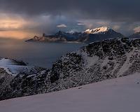 View from summit of Ryten towards distant mountains of Flakstadøy, Moskenesøy, Lofoten Islands, Norway