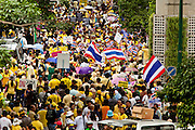 """22 JUNE 2011 - BANGKOK, THAILAND: Thai Yellow Shirts close Sukhumvit Rd, one of Bangkok's main streets, and call for a no vote during a pre-election rally in Bangkok on Wednesday, June 22. The PAD (People's Alliance for Democracy) or Yellow Shirts, as they are popularly called, has called for a """"No"""" vote in Thailand's national election, scheduled for July 3. PAD leadership hopes the no vote will negate the vote of Yingluck Shinawatra, leader of the Pheua Thai party. Yingluck is the youngest sister of exiled former Prime Minister Thaksin Shinawatra, deposed by a military coup in 2006. Yingluck is currently leading in opinion polls, running well ahead of incumbent Prime Minister Abhisit Vejjajiva, head of the Democrat party, which in one form or another has ruled Thailand for most of the last 60 years.     Photo by Jack Kurtz"""
