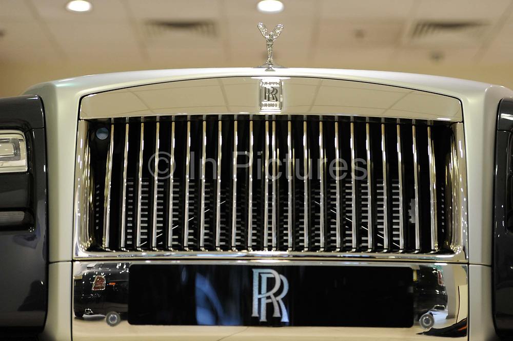 A spirit of ecstacy hood ornament on a Rolls Royce in a showroom in Berkley Square, London.