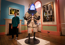 © Licensed to London News Pictures. 11/06/2019. London, UK. 'Umbilical Progenitor, 2018', a life-size graphite figure featuring a cast resin African mask by artist and curator Zak Ové is showcased at the 'Get Up, Stand Up Now: Generations of Black Creative Pioneers' exhibition at Somerset House, London. This major new exhibition celebrates the past 50 years of Black creativity in Britain and beyond. Beginning with the radical Black filmmaker Horace Ové and his dynamic circle of Windrush generation creative peers and extending to today's brilliant young Black talent globally, a group of around 100 interdisciplinary artists are showcasing their work together for the first time, exploring Black experience and influence, from the post-war era to the present day. The exhibition opens on June 12, 2019 and runs until September 15, 2019.  Photo credit: Peter Macdiarmid/LNP