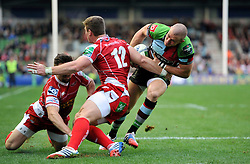 Harlequins fullback Mike Brown is tackled as he runs in his second try of the match - Photo mandatory by-line: Patrick Khachfe/JMP - Tel: Mobile: 07966 386802 12/10/2013 - SPORT - RUGBY UNION - Twickenham Stoop - London - Harlequins V Scarlets - Heineken Cup