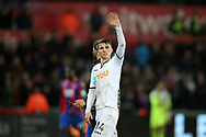 Tom Carroll of Swansea city waves to the fans after the match. Premier league match, Swansea city v Crystal Palace at the Liberty Stadium in Swansea, South Wales on Saturday 23rd December 2017.<br /> pic by  Andrew Orchard, Andrew Orchard sports photography.