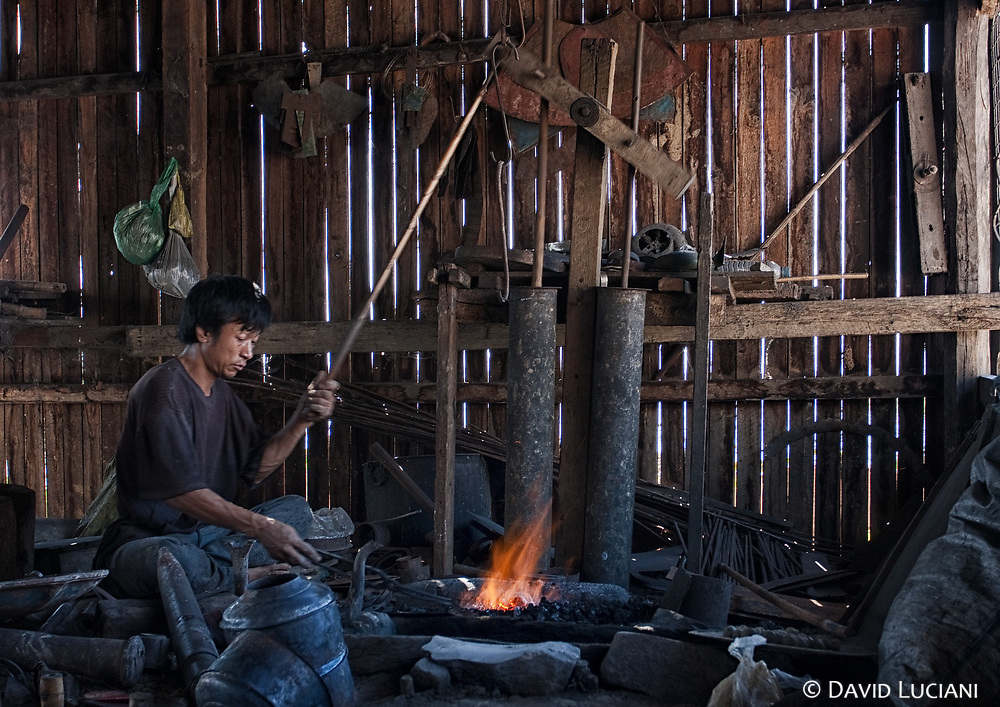 Most of all the essential items required in live are produced by the locals like this blacksmith.