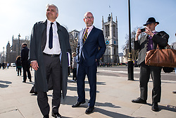 © Licensed to London News Pictures . 27/03/2017 . London , UK . PATRICK O'FLYNN and PAUL NUTTALL look at flowers and tributes fixed to fixtures outside Parliament in Westminster , adjacent to Carriage Gates , left by well wishers in response to Khalid Masood's terrorist attack and the killing of PC Keith Palmer . Photo credit: Joel Goodman/LNP