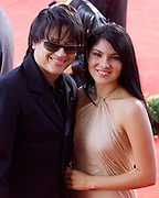 Latin music stars Elivis Crespo of Merengue (L) and singer Jaci Velazquez pose for pictures during arrivals at the 2002 Latin Billboard Awards show taping in Miami Beach, Florida May 9, 2002. The event, which showcases the music industry's hotest latin music stars, will air on the Telemundo network, May 12, 2002. PHOTO BY: COLIN BRALEY
