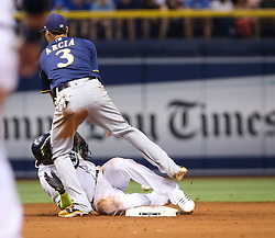August 5, 2017 - St. Petersburg, Florida, U.S. - WILL VRAGOVIC       Times.Tampa Bay Rays shortstop Adeiny Hechavarria (11) safe on the pickoff attempt, advances on the error in the eighth inning of the game between the Milwaukee Brewers and the Tampa Bay Rays at Tropicana Field in St. Petersburg, Fla. on Saturday, August 5, 2017. (Credit Image: © Will Vragovic/Tampa Bay Times via ZUMA Wire)
