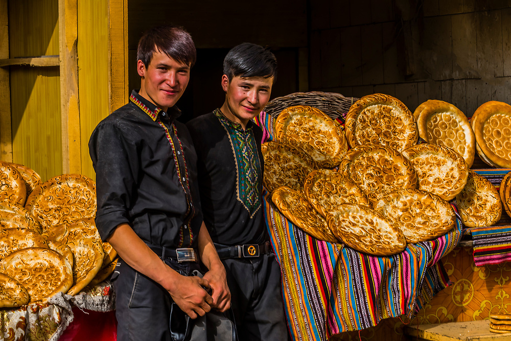 Young Uyghur men working at a bread shop with nang (the local flatbread), Yarkand, Xinjiang Province, China.