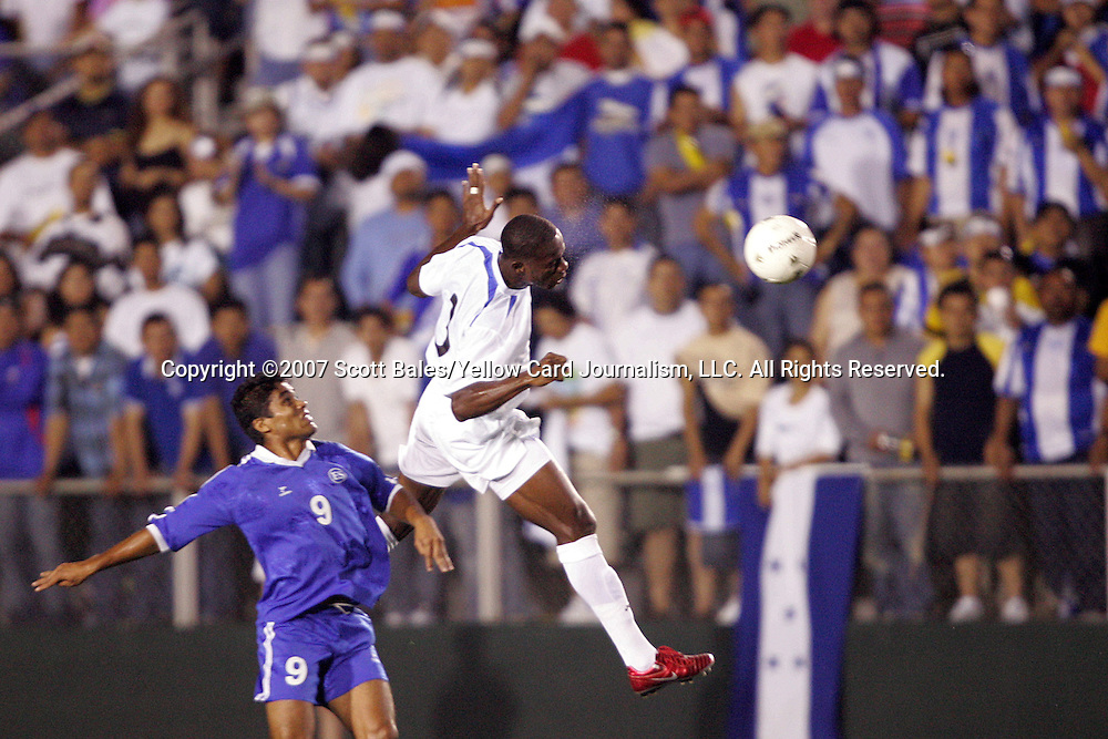 27 March 2007: Honduras's Maynor Figueroa (right) heads the ball in front of El Salvador's Juan Alexander Campos (9). The National Team of Honduras defeated the National Team of El Salvador 2-0 at SAS Stadium in Cary, North Carolina in an International Friendly soccer match.