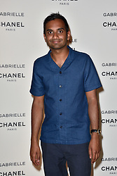 """Aziz Ansari attending the party for the new Chanel perfume """"Gabrielle"""", at the Palais de Tokyo in Paris, France, on July 4, 2017. Photo by Alban Wyters/ABACAPRESS.COM"""