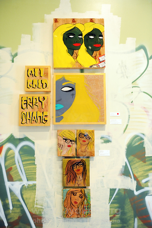 """An arrangement of three 2013 acrylic works by Da Leo. From the top: """"The Twins,"""" with comment """"Seeing Double,"""" """"All Gold Erry Thang,"""" with comment """"This one is an evolution on my hand style and the art emerging from graffiti,"""" and """"The Blonde,"""" with comment """"Hipster Marylyn, glasses without lenses, eyes closed but open."""" The works are part of """"Respect Through Sacrifice,"""" Da Leo's exhibition which runs through January 4th, 2014 at the National Steinbeck Center in Salinas."""