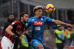 January 26, 2019 - Milan, Milan, Italy - Kevin Malcuit #2 of SSC Napoli competes for the ball with Hakan Calhanoglu #10 of AC Milan during the serie A match between AC Milan and SSC Napoli at Stadio Giuseppe Meazza on January 26, 2018 in Milan, Italy. (Credit Image: © Giuseppe Cottini/NurPhoto via ZUMA Press)