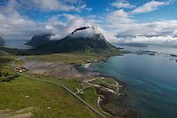 Highway E10 winds its way below Volandstind mountain peak, Flakstadøy, Lofoten Islands, Norway