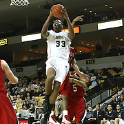 Central Florida forward Keith Clanton (33) drives to the net against Louisville during their game at the UCF Arena on December 15, 2010 in Orlando, Florida. UCF won the game79-58. (AP Photo/Alex Menendez)
