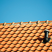 blue sky and red tiles on a rooftop