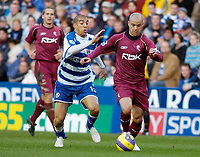 Photo: Gareth Davies.<br />Reading v Bolton Wanderers. The Barclays Premiership. 02/12/2006.<br />Reading's James Harper (L) challenges with Bolton's Stelios (R)