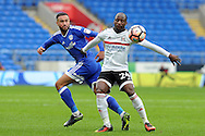 Fulham's Sone Aluko (r) shields the ball from Cardiff City's Jazz Richards. The Emirates FA Cup, 3rd round match, Cardiff city v Fulham at the Cardiff city stadium in Cardiff, South Wales on Sunday 8th January 2017.<br /> pic by Carl Robertson, Andrew Orchard sports photography.