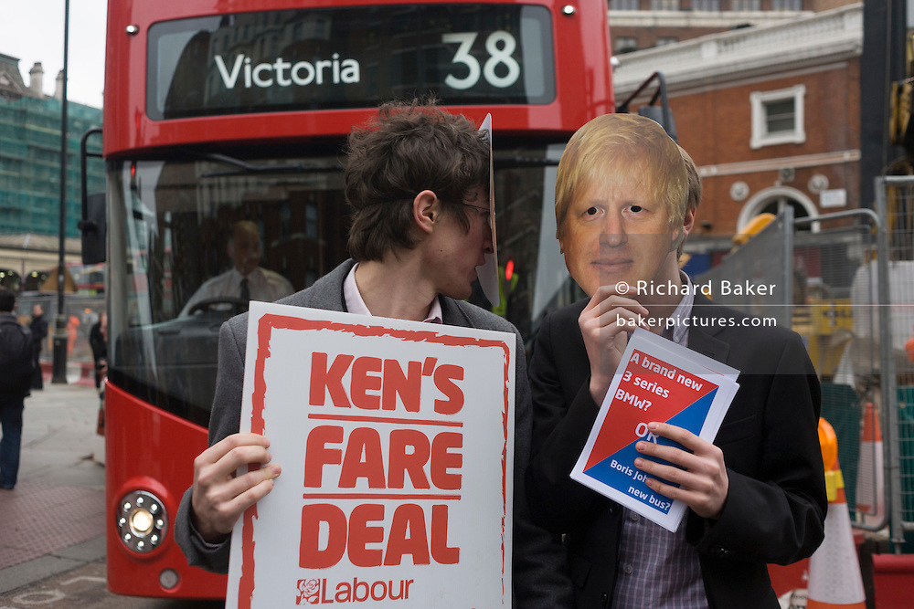 Supporters of mayoral rival Ken Livingstone disrupt Boris Johnson's fanfare launch of London's newest red double-decker Routemaster (27th Feb 2012) bus which is seen in service on the capital's streets for the first time. The hybrid NB4L, or the Borismaster, New Routemaster or Boris Bus, is a 21st century replacement of the iconic Routemaster as a bus built specifically for use in London and is said to be 40 per cent more fuel efficient than conventional diesel buses. The brainchild of London's Conservative mayor Boris Johnson, its funding has been controversial amid massive fare increases in transport.
