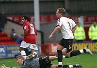 Photo: Dave Linney.<br />Walsall v Barnet. Coca Cola League 2. 24/02/2007.<br />Walsall's Kevin Harper fires past Barnet Keeper Robert Burch to make it 3-1 to the Saddlers.